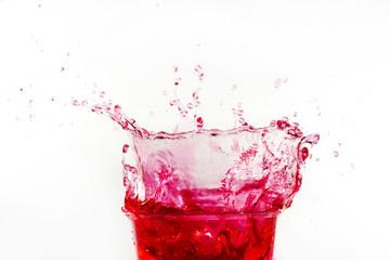 close up red cocktail splashing