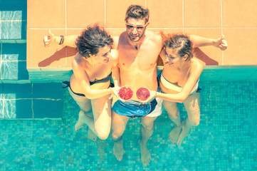Attractive young friends having fun in a swimming pool