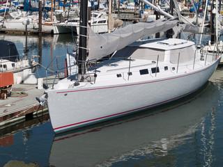 Sailboat Tied Up at Dock in Marina