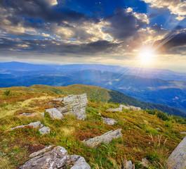 stones on the hillside at sunset
