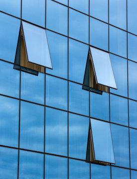 reflection in open windows  of  skyscraper