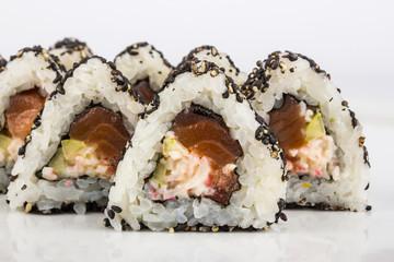 triangular sushi with sesame seeds