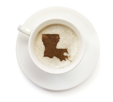 Cup of coffee with foam and powder in the shape of Louisiana.(se