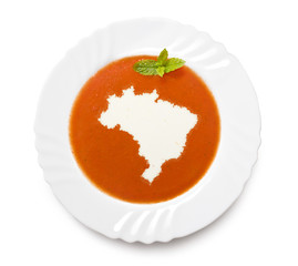 Plate tomato soup with cream in the shape of Brazil.(series)