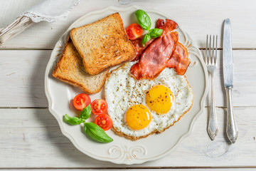 Toast, eggs and bacon for breakfast