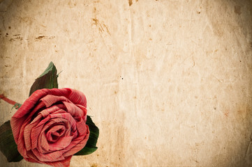 Vintage paper with red rose