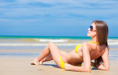 long haired woman bikini on tropical beach