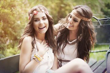 Portrait of happy boho female friends in park