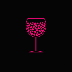 Wine glass with pink hearts inside. Black background.