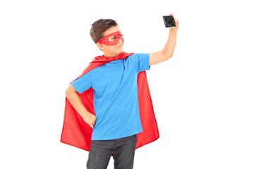 Boy in superhero costume taking a selfie