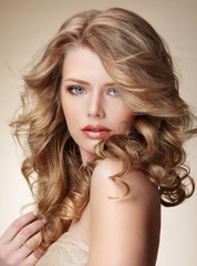 Woman with Perfect Skin and Flowing Blond Healthy Hair