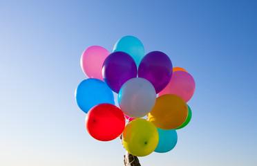 flying huge balloons blue sky