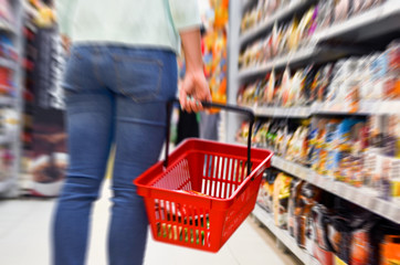 Hand holding empty shopping basket - Shopping concept