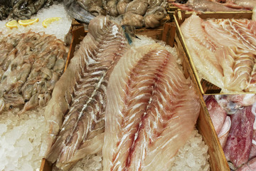 Group of raw sea products on a table.