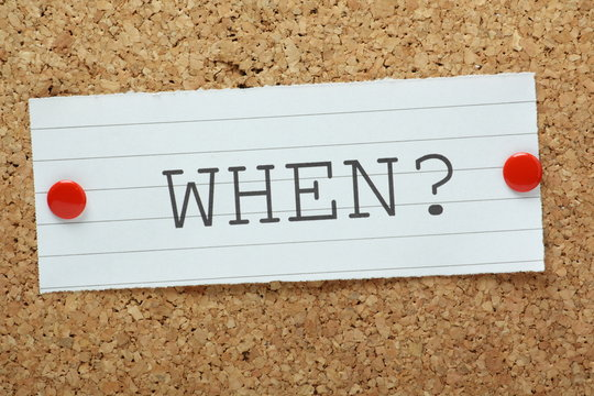 The question When? on a cork notice board