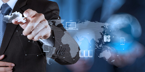 Wall Mural - Businessman working with a Cloud Computing diagram on the new co