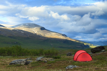 Red tent in the mountains of Lapland, Sweden.