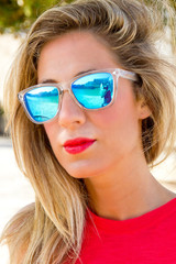Pretty blond woman with sun glasses