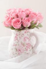 fresh pink roses in a beautiful ceramic vase