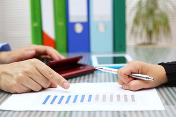 businessmen explaining report sales to client