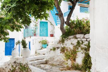 Fototapete - Griechenland: typische Hausfassade in Blau und Weiß