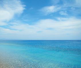 Blue sea and cloudy sky