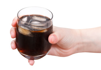 hand holding cola with ice in glass