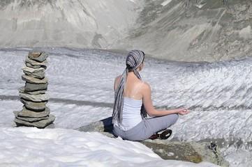 girl meditates in mountains