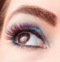 Closeup portrait of colored eyelash extensions