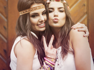 Portrait of two beautiful summer girls