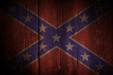 Southern flag over a grunge wooden background.