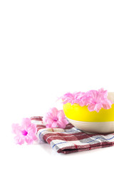 ceramic bowl with pink flower on a cloth