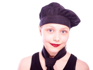 Teen girl dressed in chef hat
