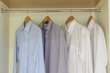 shirts hanging in wardrobe
