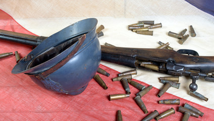 french helmet of the First World War with a gun on a blue white