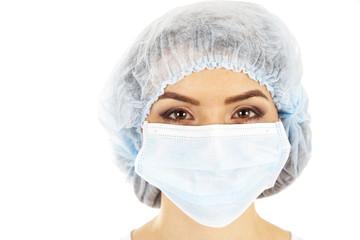 female doctor in a mask closeup.