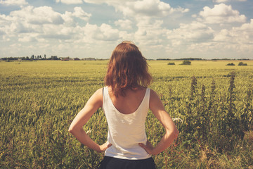 Young woman standing in a field