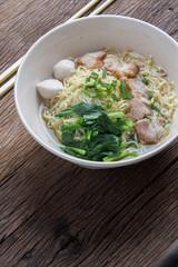 Noodles bowl on wooden background