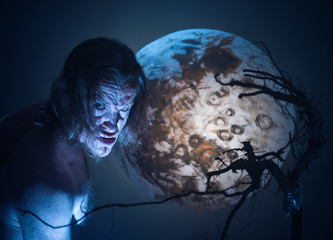 Scary man on moon background