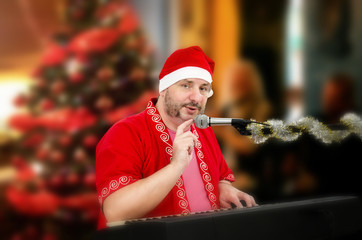 Santa Claus tapping microphone
