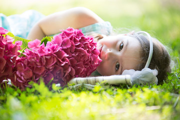little girl is sleeping in nature