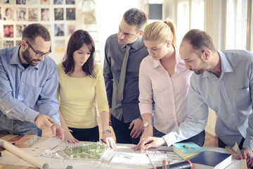 Group of Architects with teacher working at project