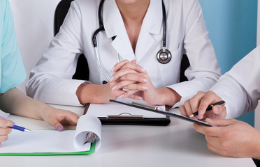 Hands of doctors with clipboards