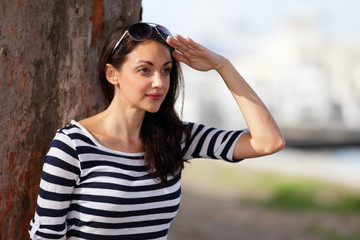 Woman with hand on forehead stock image