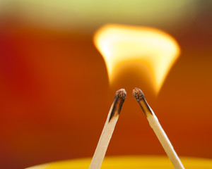 Two matches dancing under their fire