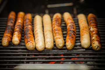 sausages at grill