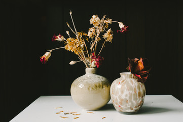 Two Vases Filled with Flowers and Dried Roses