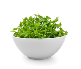 Watercress in bowl on white background