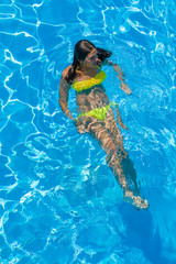 Young woman at the swimming pool