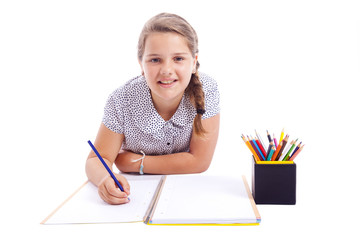 Child girl drawing with pencil, isolated on white background